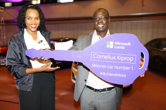 Microsoft Mobile devices GM for East Africa Ms. Mariam Abdullahi with one of the 5 Chevrolet cruze Winner Cornelius Kiprop