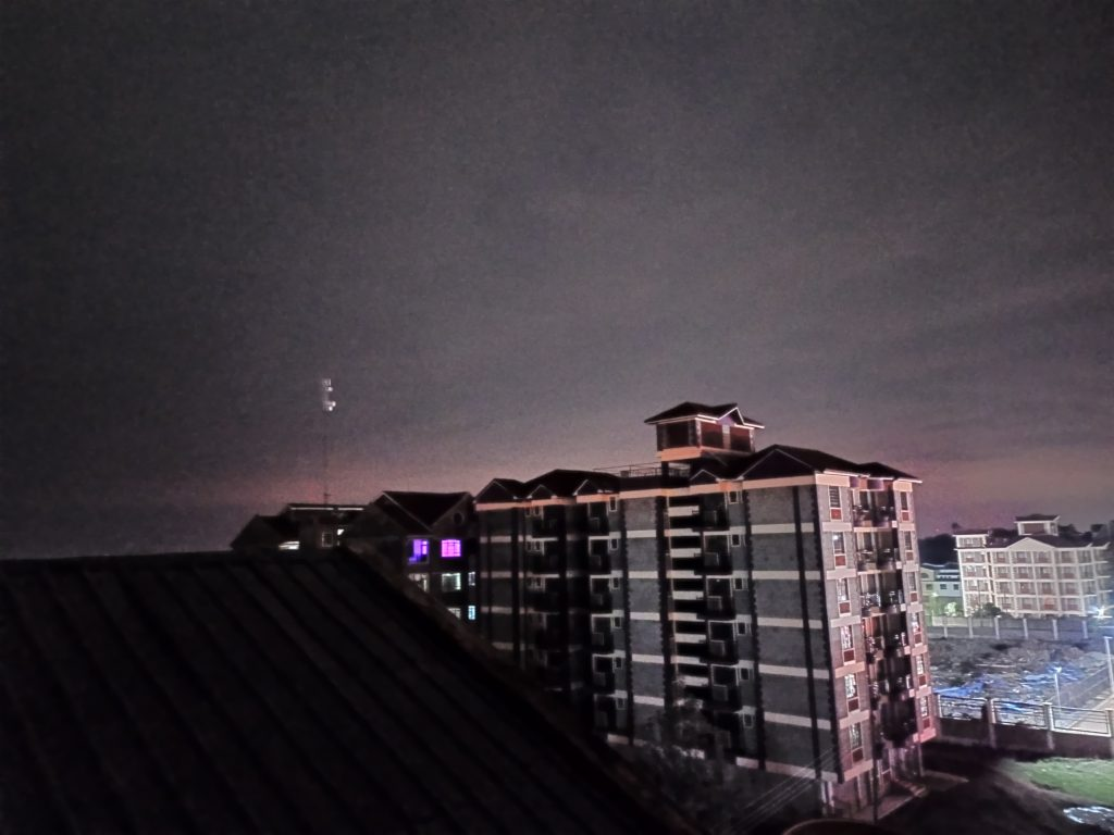 Super Night shot showing visible building and sky